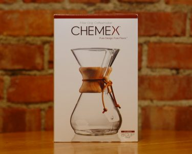 Chemex Coffee Brewer packaged in a white box setting on a table