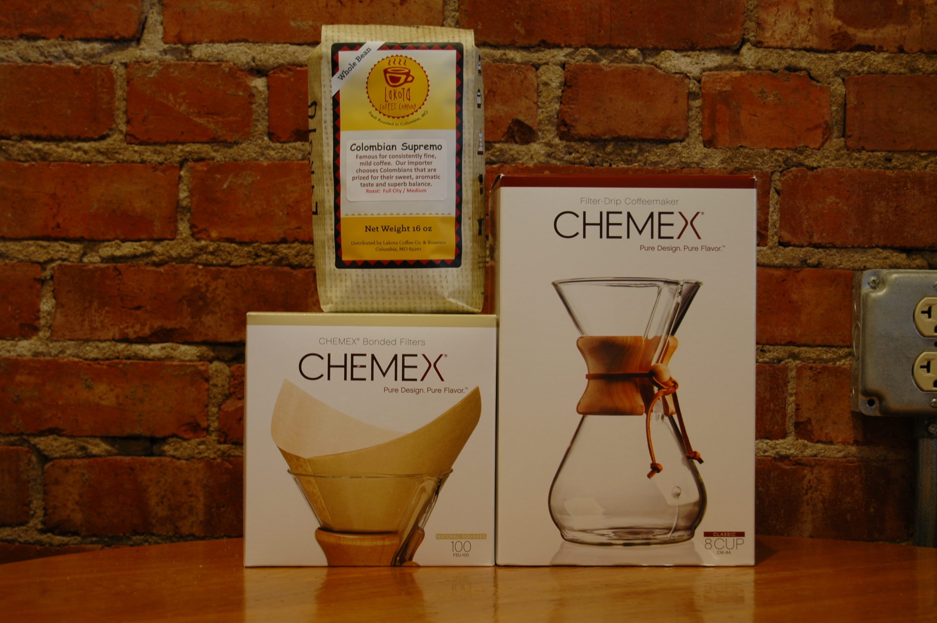 Chemex products including filter-drip coffeemaker and bonded filters alongside a bag of Lakota Coffee Company Columbia Supremo