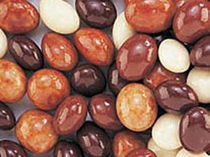 Multicolored chocolate covered espresso beans up close image