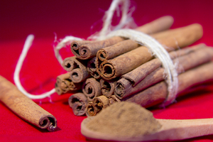 Cinnamon sticks wrapped together in white twine