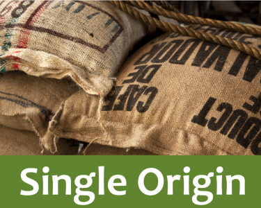 Single origin coffee written in a white font with a green label behind