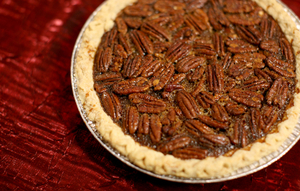 Southern pecan flavored pie setting in a pie tin