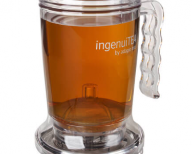 Clear, loose leaf tea infuser with tea inside