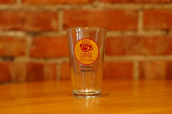 Clear tall glass with Lakota Coffee Company logo