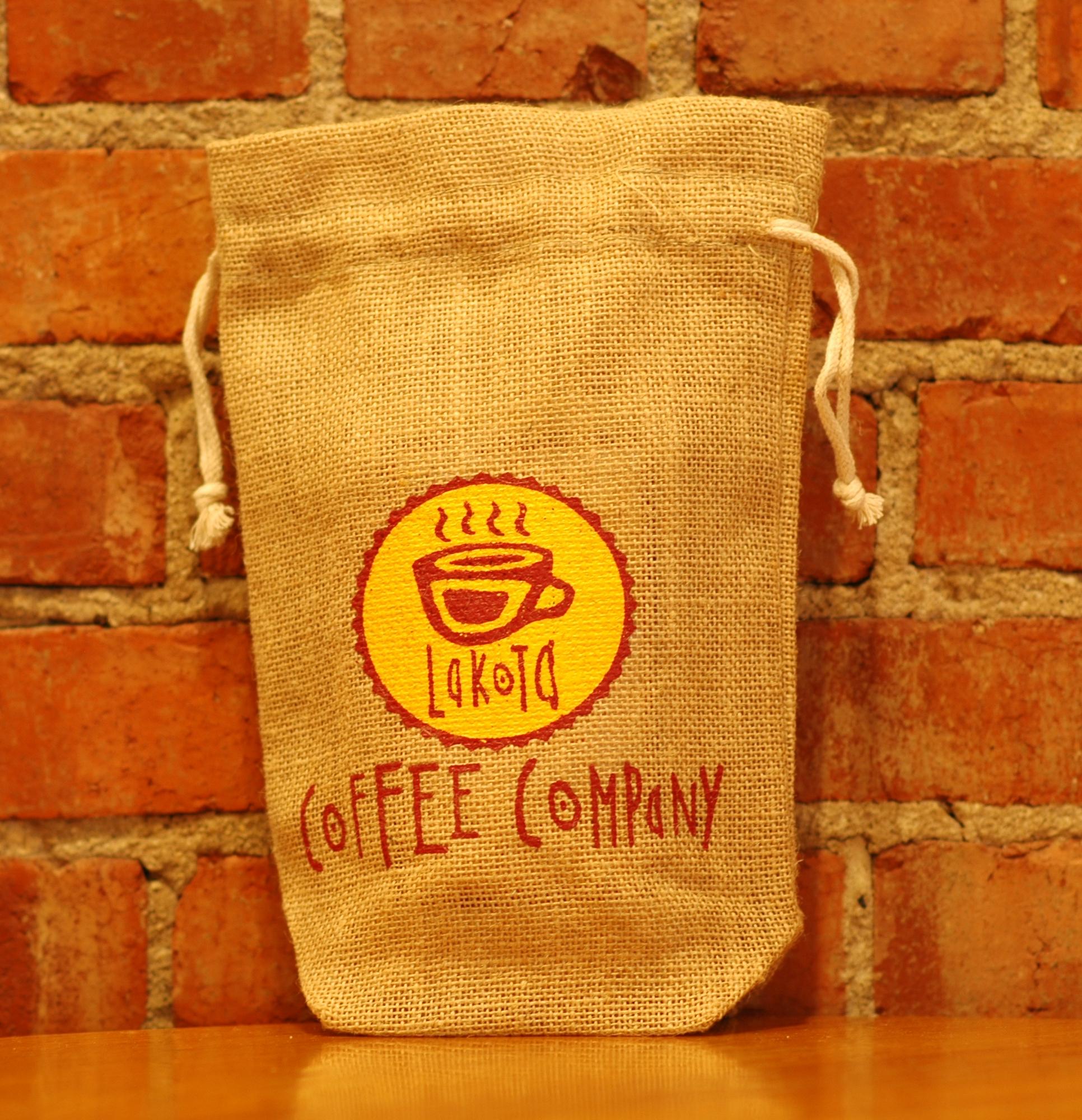 Burlap, drawstring bag with Lakota Coffee Company logo on the front