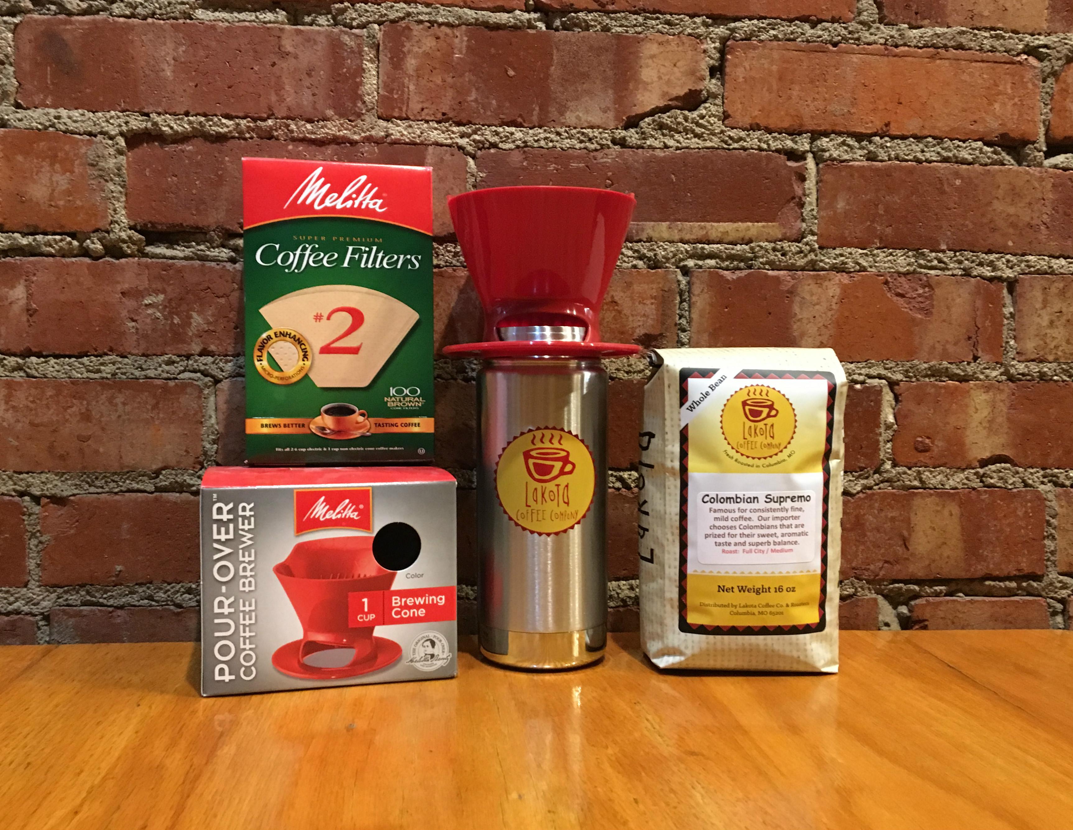 Lakota Coffee Company Klean Canteen, coffee bag, coffee filters and, coffee brewer setting on table